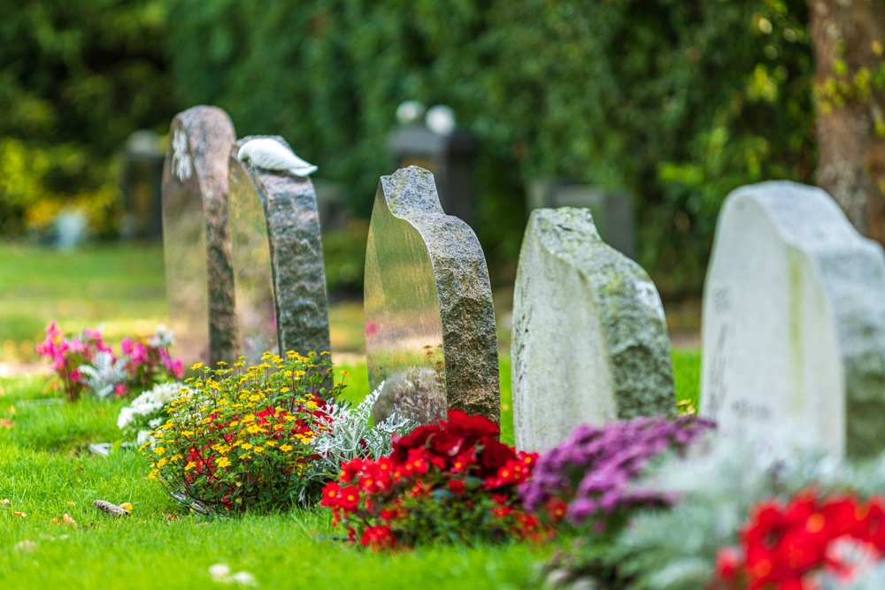 Decorating soldier's grave stones with flowers for Memorial Day