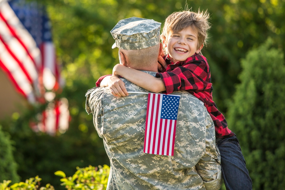 American,Soldier,Reunited,With,Son,On,A,Sunny,Day,With