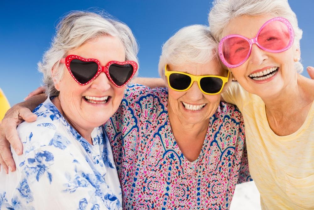 Senior women wearing sunglasses for skin protection.