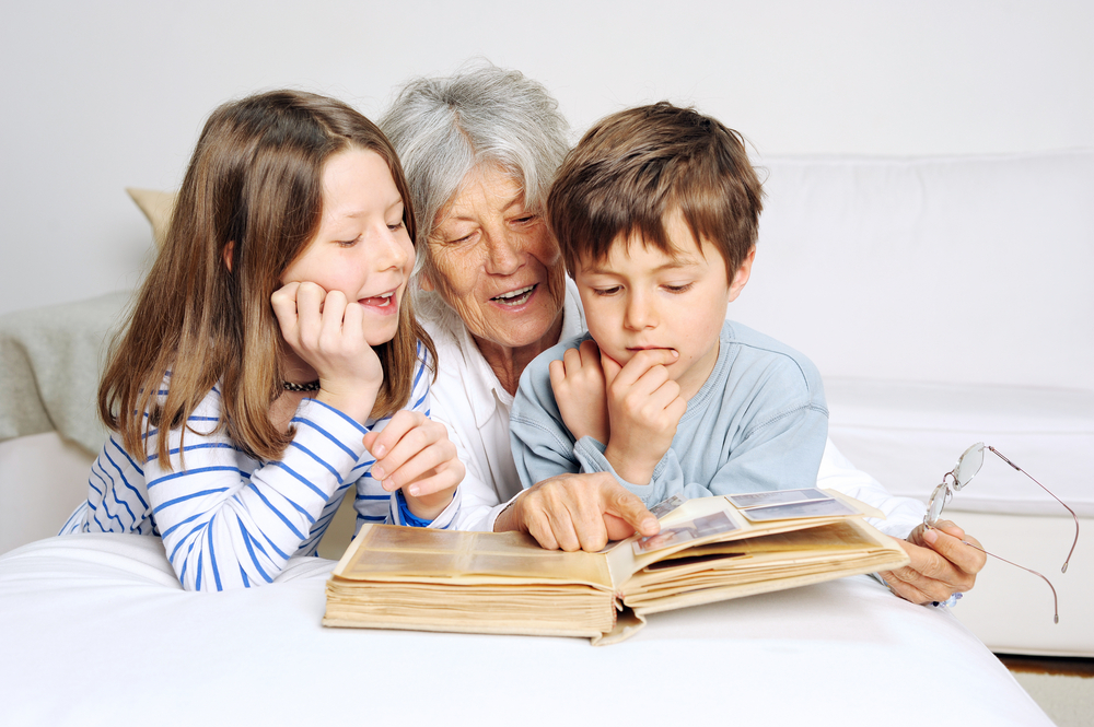 Looking at a family photo album on National Senior Citizens Day
